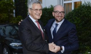 Charles Michel (R), here with coalition colleague Kris Peeters, will be Belgium's youngest PM since 1841
