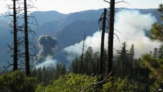 Smoke rises from a plane crash in Yosemite National Park in California on 7 October 2014