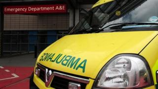 Ambulance outside the entrance to a hospital Accident and Emergency