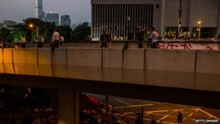 Pro-democracy protesters walk on an overpass outside Hong Kong's Government complex on 8 October 2014 in Hong Kong, Hong Kong