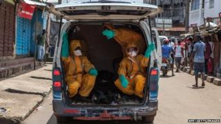 Volunteers arrive to pick up bodies of those who have died from Ebola in Freetown, the capital of Sierra Leone