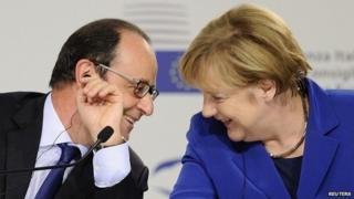 President Hollande and Chancellor Merkel chat at summit