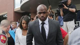 Minnesota Vikings running back Adrian Peterson appeared with his wife, Ashley Brown Peterson, in Conroe, Texas, on 8 October 2014