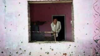 An Indian villager stands inside a damaged room of a house following alleged fire from the Pakistani side of the disputed Kashmir border, at Chalyari Village in Samba sector 65 KM from Jammu,