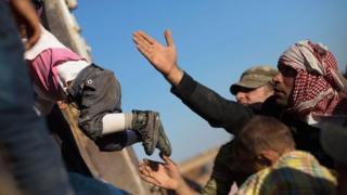 Refugees fleeing Isis, near Turkish border, October 2014