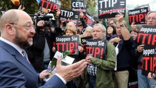 President of the European Parliament Martin Schulz (left) speaks with anti-TTIP protesters in Berlin
