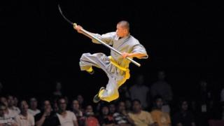 A Shaolin monk performs during the World Guoshu Competition Finals in Hong Kong in 2009.