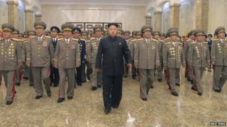 North Korean leader Kim Jong Un (C) visits the Kumsusan Palace of the Sun to pay tribute to founding President Kim Il Sung and former leader Kim Jong Il to mark the 61st anniversary of the victory of the Korean people in the Fatherland Liberation War, in this file photo released by North Korea's Korean Central News Agency (KCNA) in Pyongyang 27 July 2014