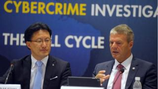 Troles Oerting and executive director of Interpol Noboru Nakatani
