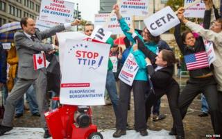 Activists protest against the TTIP and CETA in Berlin on 11 October 2014