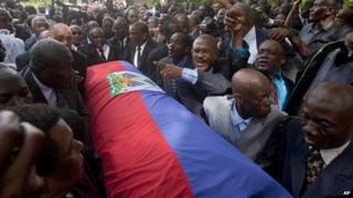 JC Duvalier's coffin draped with the Haitian flag