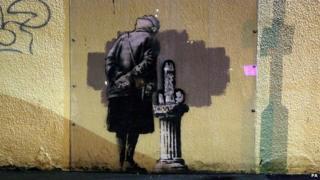 Vandalised Banksy image