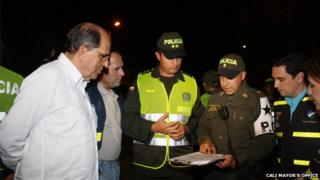 Mayor of Cali Dr Rodrigo Guerrero with police officers in the city of Cali