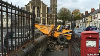 Dumper truck smashes through a wall in Cardiff