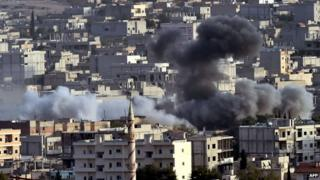 Smoke from an air strike on the Syrian town of Kobane on 13 October 2014