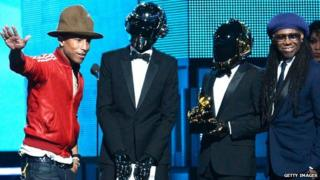 Daft Punk with Pharrell Williams (l) and Nile Rodgers at the 2014 Grammys
