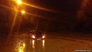 Car submerged in Anchor Lane, Wadesmill