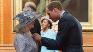 Sue Jones receives her MBE from Prince William