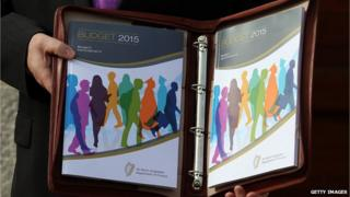 Irish Finance Minister Michael Noonan holding the 2015 budget