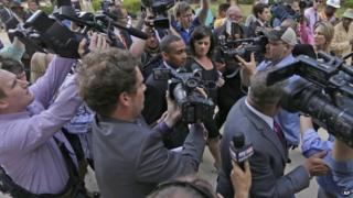 Former Charlotte Mayor Patrick Cannon, center, is surrounded by media as he leaves the federal courthouse in Charlotte, North Carolina, 14 October 2014