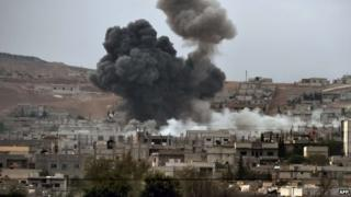 Smoke rises from the Syrian town of Kobane after a strike from the US-led coalition, 14 October