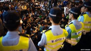 Media in China defend Hong Kong's police force after reported scuffles between officers and pro-democracy protesters.