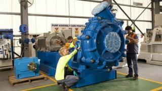 Weir Group staff working on pump
