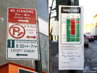 New York street sign (left) improved by Nikki Sylianteng (right)
