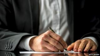 Man writing will