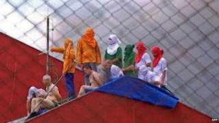 A screen grab from TV Cultura shows inmates atop a roof during a riot at the prison in Guarapuava - 14 October, 2014