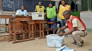 Election officials in Mozambique count votes at a polling station in Maputo - 15 October 2014