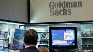 Financial professionals sit in the Goldman Sachs