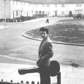 George Harrison outside his childhood home
