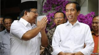 Indonesia's losing presidential candidate Prabowo Subianto (L) gestures as he stands beside Indonesia's President-elect Joko Widodo after a meeting in Jakarta, 17 October 2014.