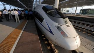 A high-speed train arrives at the Bengbu station, east China's Anhui province, one of the stops of the Beijing to Shanghai line which was launched on June 30, 2011