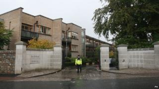 Police officer stands guard at the apartment block where the boy's body was found