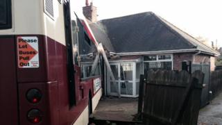 Bus crashed in house