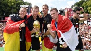German football players holding trophy