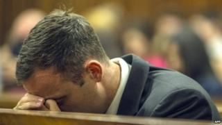 South African athlete Oscar Pistorius rests his head during his sentencing hearing at the North Gauteng High Court in Pretoria, 17 October 2014