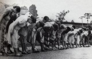 Women bowing