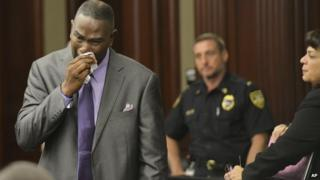 Ron Davis, the father of Jordan Davis, wipes away tears after reading his victim's impact statement to the court, during Michael Dunn's sentencing hearing 17 October 2014
