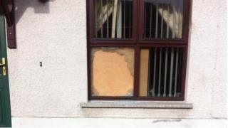 A window was broken at the property in Dunmurry
