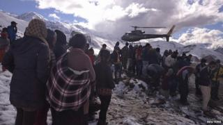 Rescue helicopters are again searching the mountainsides