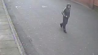 CCTV image of man who police believe may be able to help them with their inquiries into a serious assault in Glasgow