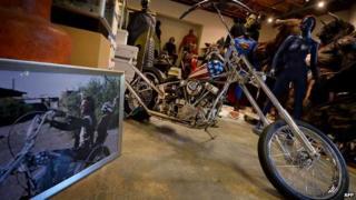Easy Rider bike beside a still of Peter Fonda from the film