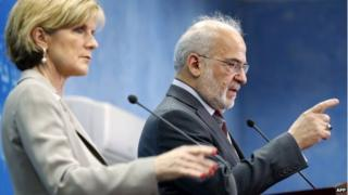 Iraqi Foreign Minister Ibrahim al-Jaafari (R) speaks as Australian Foreign Minister Julie Bishop looks on at a press conference in Baghdad on October 18