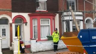 Police outside a house in Portsmouth