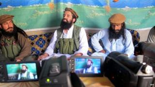 A picture made available on 15 October 2014 shows Shahidullah Shahid (C), the spokesman of Pakistani Taliban speaking to journalists at an undisclosed location near the Pak-Afghan border, 21 February 2014.