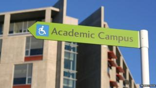"""A sign saying """"Academic Campus"""" with an accessible wheelchair sign."""
