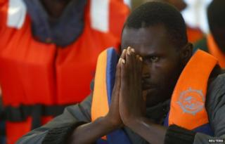 A sub-Saharan migrant arrives on a ship in Pozzallo, Sicily (5 Oct 2014)
